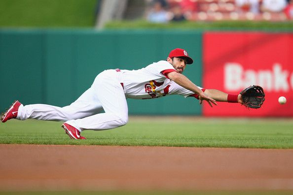 Matt Carpenter attempts to field a ground ball against the Pirates in the first inning - August 13, 2013
