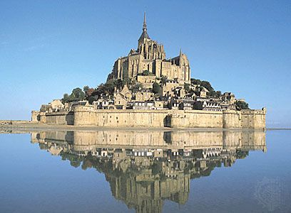 Like something out of a fairy tale. Try to stay at a hotel within Mont St. Michel!