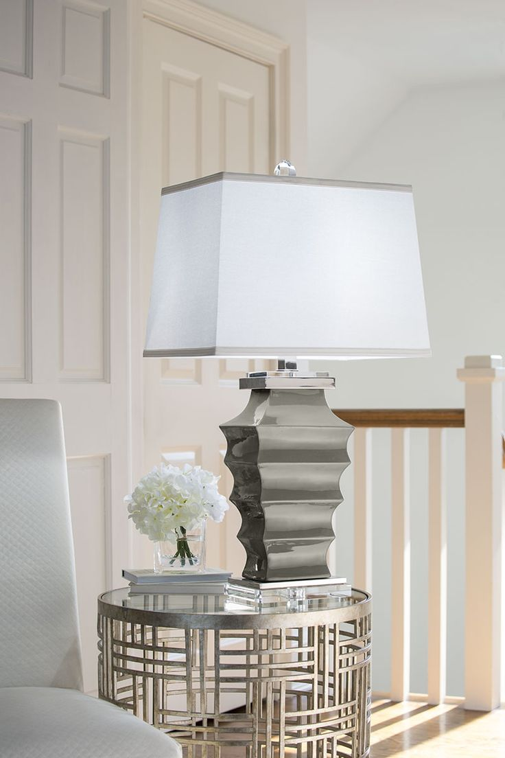 Room Decor With Contemporary Grey Ceramic Lamp And Hand Wrought Iron Table  In Antiqued Silver Leaf;