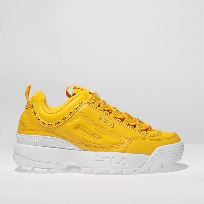 39a689ce womens yellow fila disruptor ii premium repeat trainers ...