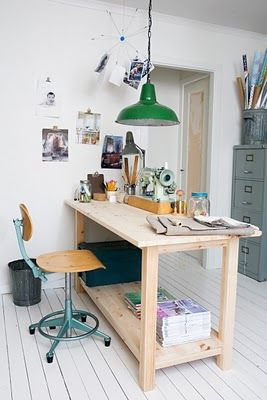 creative space - love the old trash can for wrapping paper