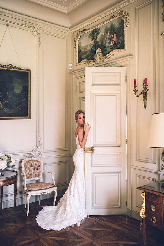 The French Bedroom Company Blog | 10 French Wedding Traditions. if you're getting married in France or are a wedding guest these are some elements you can expect. France is a popular wedding destination with beautiful wedding venue, lovely weather, romantic location, and delicious food. Think couqembouce, macaron cakes, champagne pyramid, wedding flowers and pretty wedding. beautiful bride in French chateau with white dress and train - stunning.