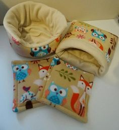 Guinea pig/hedgehog bedding set Cuddle cup Approx 11 inch base x 6 inches high Snuggle sack Fully lined with polyester quilt wadding and support in the entrance 11 x 11 inches approx 2 x cage pads For use in corners/under leaky bottles to help keep your pets dry and clean. Made from the popular woodlands fleece and plain stone fleece. Please note the fabric has quite a large print so the position of animals may vary from stock photo
