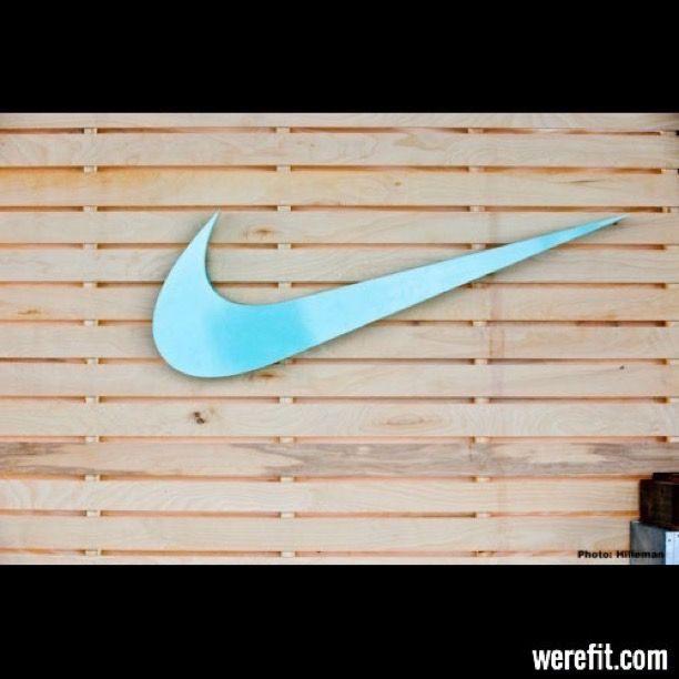 Nike Swoosh Logo On Wood