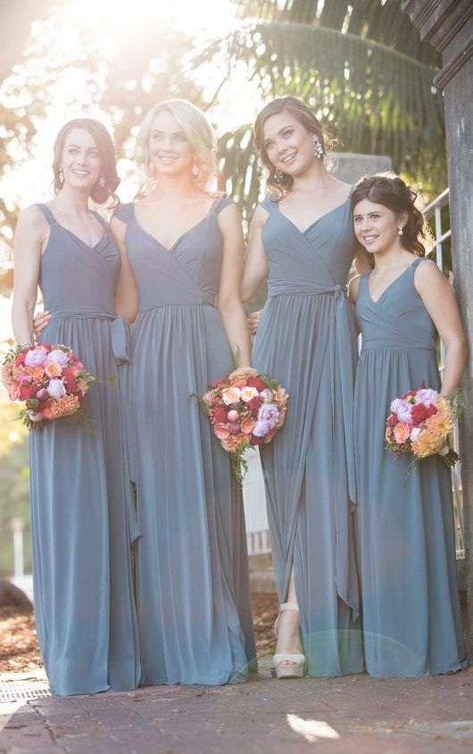 (IV3124) A true wrap dress, this bridesmaid dress can be adjusted to fit – and accentuate – all body types. Constructed with the soft Luxe Double Knit, it's silhouette flows freely as you walk. And with its adjustable straps, you can create a sweet cap sleeve style, or simple straps.
