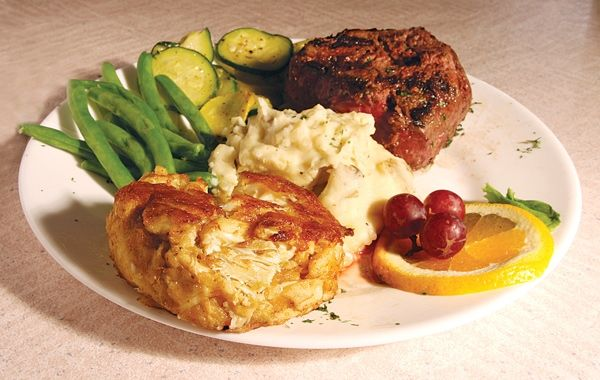 """Oceanfront Grille at Corolla Light - Corolla, NC. The only oceanfront restaurant on the Currituck Outer Banks. They're known as """"Crabcake Heaven"""", but also offer mouth-watering steaks, plump oysters, fresh tuna and  mixed grill combinations."""