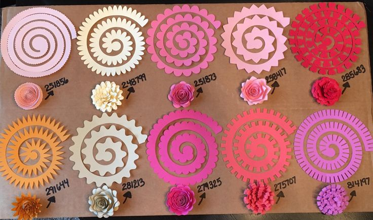 the different paper flowers you can make with the Cricut Flower Shoppe Cartridge, plus the numbers of each 3D as listed on the cartridge. these are also included with the Cricut Design Space subscription.