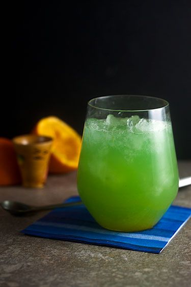 Emerald City Crush: crushed ice, 1.5 ounces Captain Morgan® original spiced rum,  ½ ounce triple sec, 1 orange (juiced), Sprite, ½ ounce blue curacao. Preparation: Fill an 8 ounces glass with crushed ice. Pour the rum over the ice, then pour in the triple sec and orange juice. Top with sprite then stir in blue curaçao. ~St. Patty's Day Drink