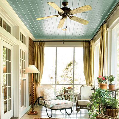 Historic Blue Porch - Porch and Patio Design Inspiration - Southern Living This porch ceiling is painted blue for a playful nod to traditional Southern Haint Blue. A fan keeps the area cool on warm Southern days, and curtains add privacy to the space.: Screened Porch, Color, Porches, Sun Room, Porch Ceiling, Sunroom