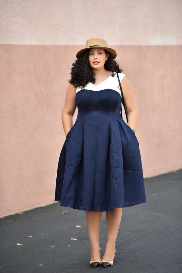 Tanesha Awasthi wears a white and blue midi dress, cap-toe nude and black pumps, and a boater hat