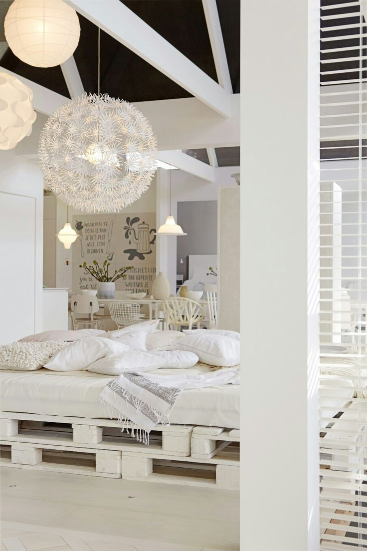 Gorgeous white bedroom with pallet bed