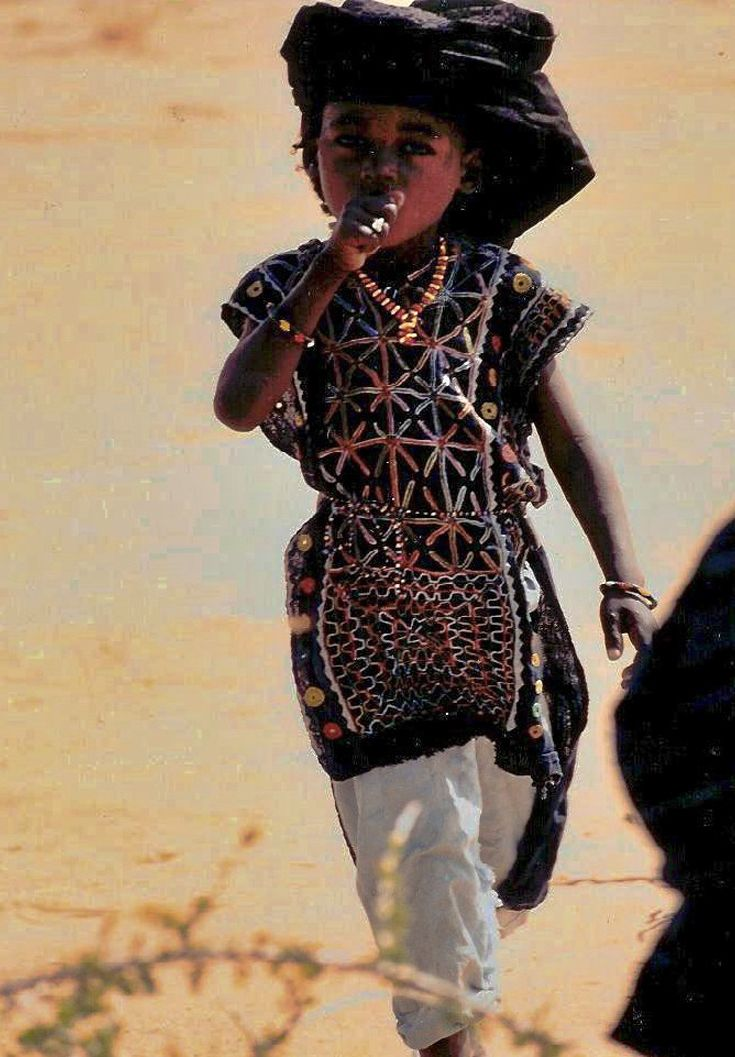 Africa | Wodaabe child in tunic, Niger | ©Marti Brown
