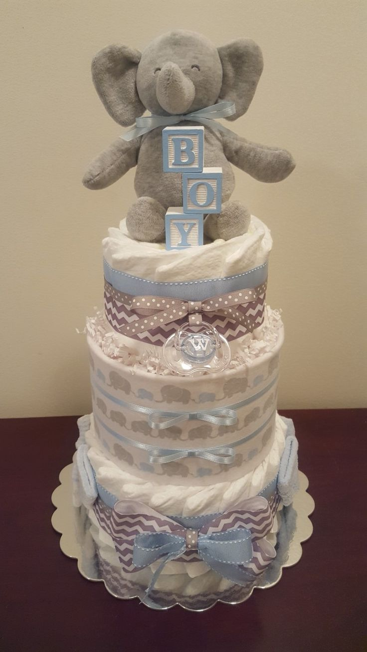 Baby blue and grey elephant diaper cake! This adorable diaper cake is perfect shower gift or centerpiece.  This one is a smaller one, includes 45 diapers.  Visit my Facebook page Simply Showers for more pics and orders.  Thanks Kim