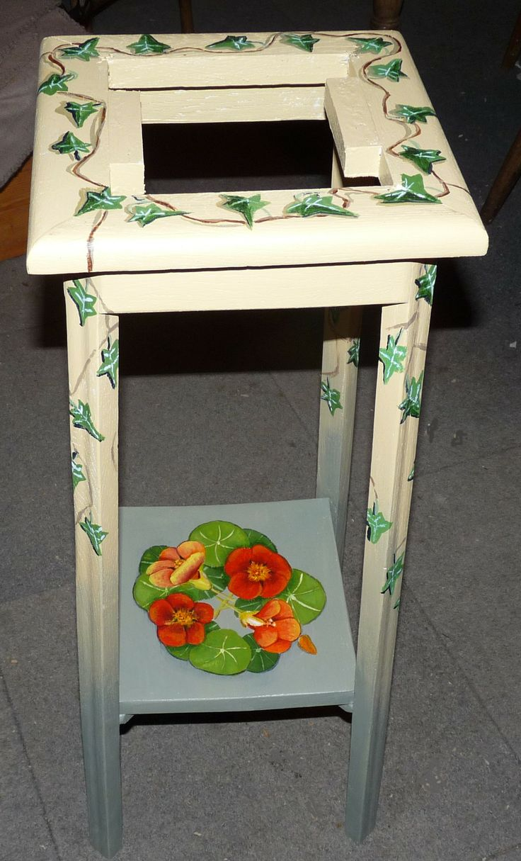 A dark mahogany pot stand, painted!