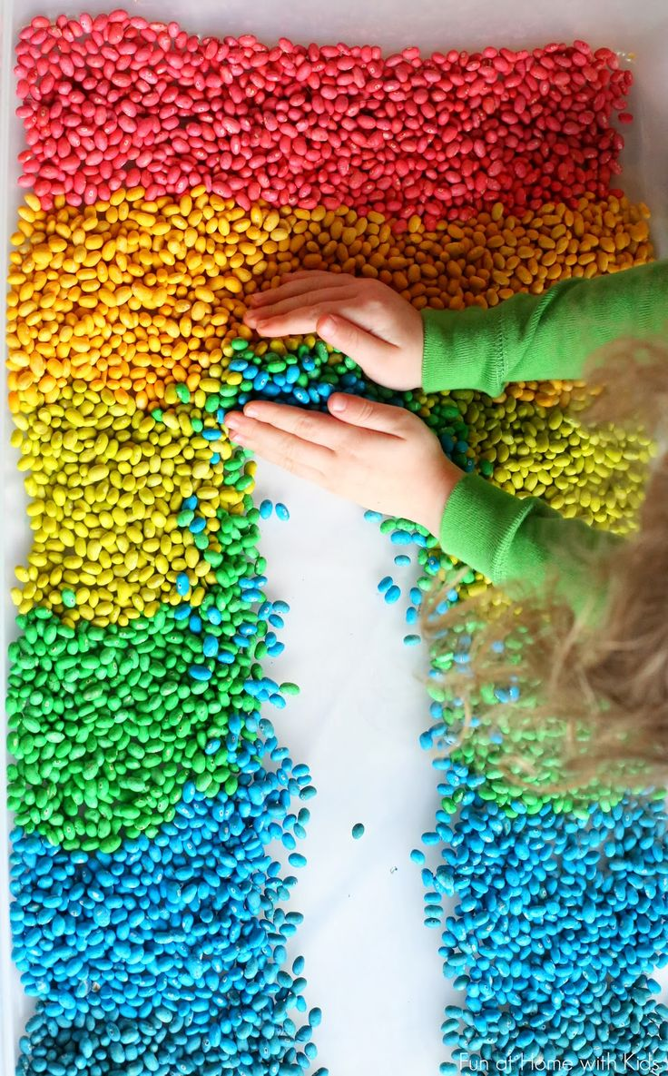 How to Color Beans for Play and Art from Fun at Home with Kids. Dry Lima or Navy beans and food coloring.