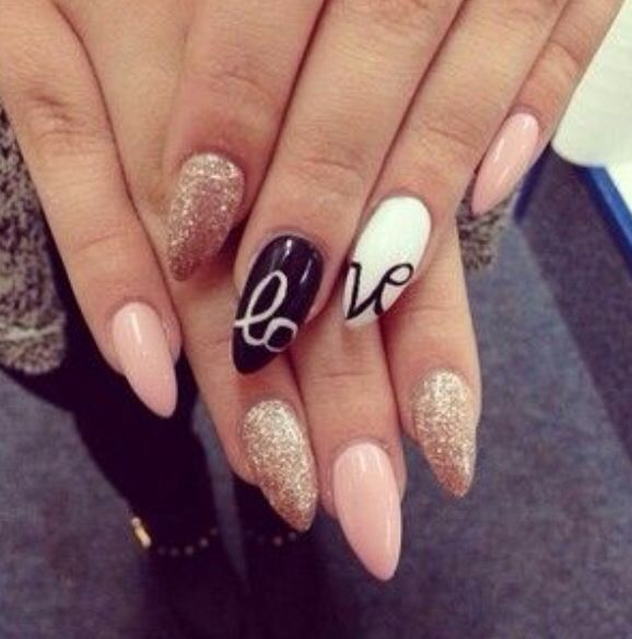Pink and gold glittery stiletto nails