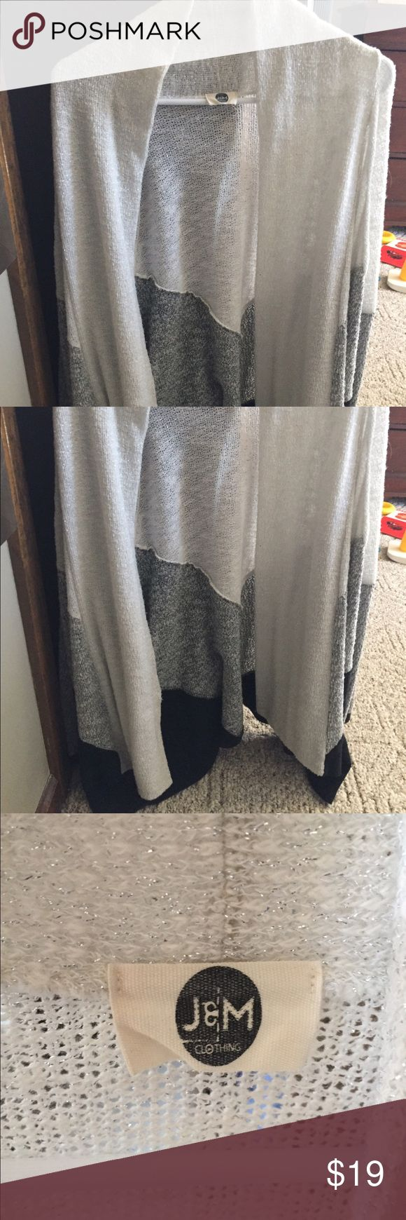 Black, white and grey knit open front cardigan Black, white and grey knit open front cardigan. Has chevron design and shimmer throughout. Size M. Originally purchased from Piace Sweaters Cardigans