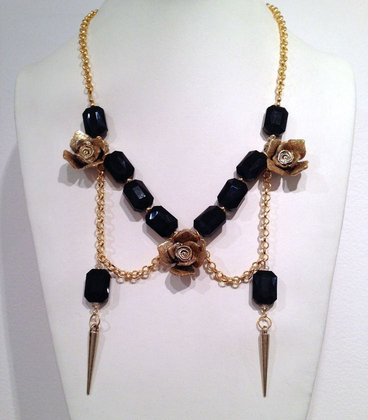 Roses, black crystals and spikes statement necklace by cheriebeadle on Etsy https://www.etsy.com/listing/223198387/roses-black-crystals-and-spikes
