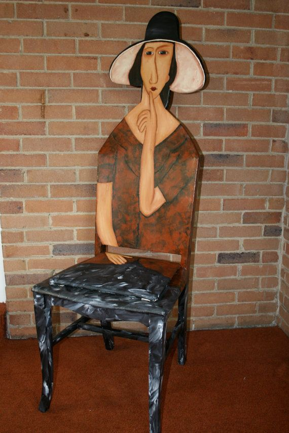 """Modigliani """"Jeanne Hebuterne in a Hat"""". Contemporary masterpiece. This custom hand-painted chair is a striking modern style painted in blends of brown, black and yellow acrylic. The back of chair also painted in Modigliani''s style. Chair has three layers of polyurethane to offer protection so that it can be a useable piece of furniture.This chair measures 55H x18W x 18DFeel free to contact me with any questions or for any customized needs.Cost for professional handling and shipping is $150…"""