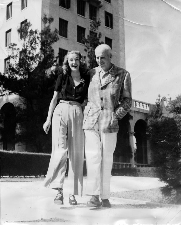 Slim Keith with Howard Hawks.  LOVE the cropped trousers and lace-up espadrilles.