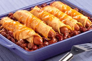 Chili Dog Casserole...2 cans of chili (your choice beans or not) 1 pkg hot dogs  6in corn torillas (I am going to use flour) Shredded Cheese Looks good!