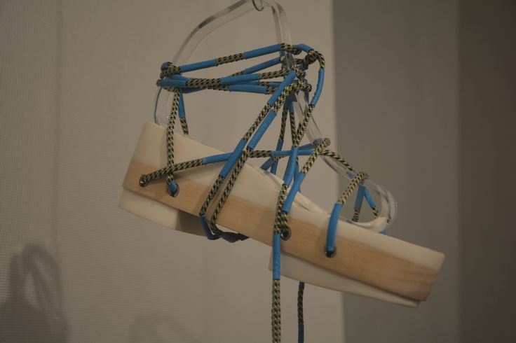 Strip Down And Build Up by Noesha Hu. This shoe has one sole for all seasons; made of wood and plastic.