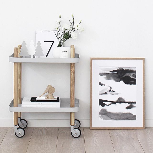 A pleasure to be sponsored by @normanncph I picked out their Block Table to style and I'm finding so many uses. I'm thinking drinks cart come Christmas Day! Love the mobility of wheels and while it was hard to choose from the gorgeous range of colours the light grey is perfect. The beautiful 'Storm at the Beach' print is by @minigrandiartist and we're finally getting a little festive with these cute Christmas Trees from @catcooee #NormannCopenhagen #BlockTable #TDCStylingandPhotography