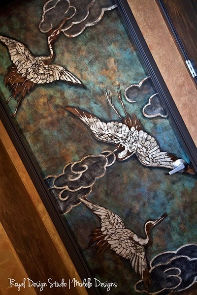 We ♥ decorating the doors here at our San Diego studio! They make ideal canvases for whatever your mind can imagine. Here are some Japanese cranes (Modello stencil EasPan 127-28) in metal leaf on a metallic foil finish.
