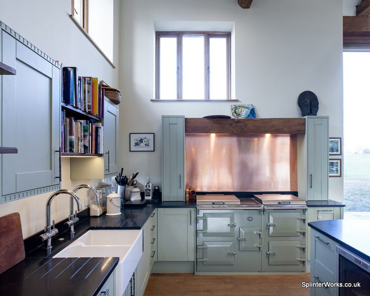 Copper + Cask:  A Kitchen by Splinter Works.   Farrow & Ball painted cupboards subtly allude to the verdigris colour of copper patina.  The oak beam above the Everhot cooker discreetly hides the extraction and lighting.