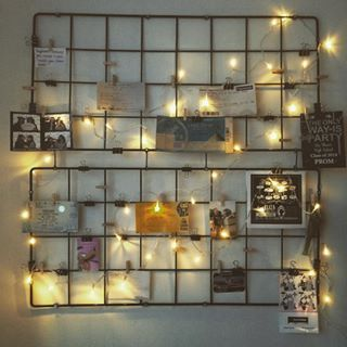 Finally, add caging to your wall with Command hooks for a damage-free way to display pictures… | 23 Cleverly Creative Ways To Decorate Your Rented Apartment