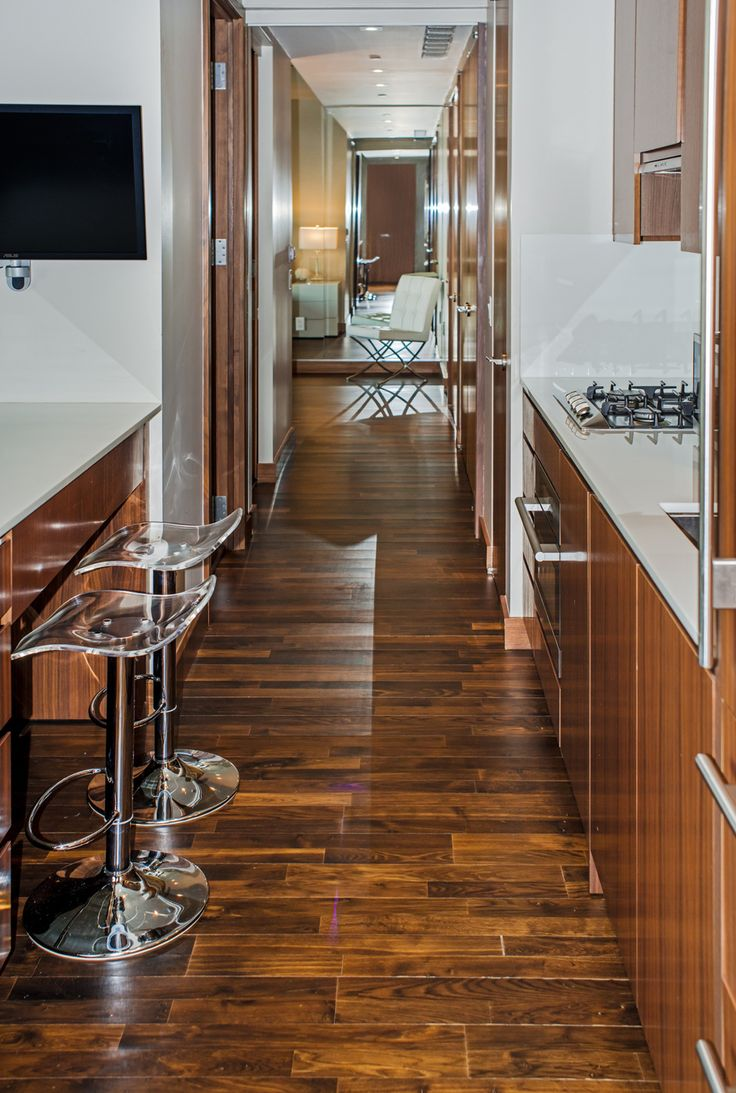 Black oak floors at the chic, spacious Midtown Jewel 43F, a New York villa located in a world class high-rise.