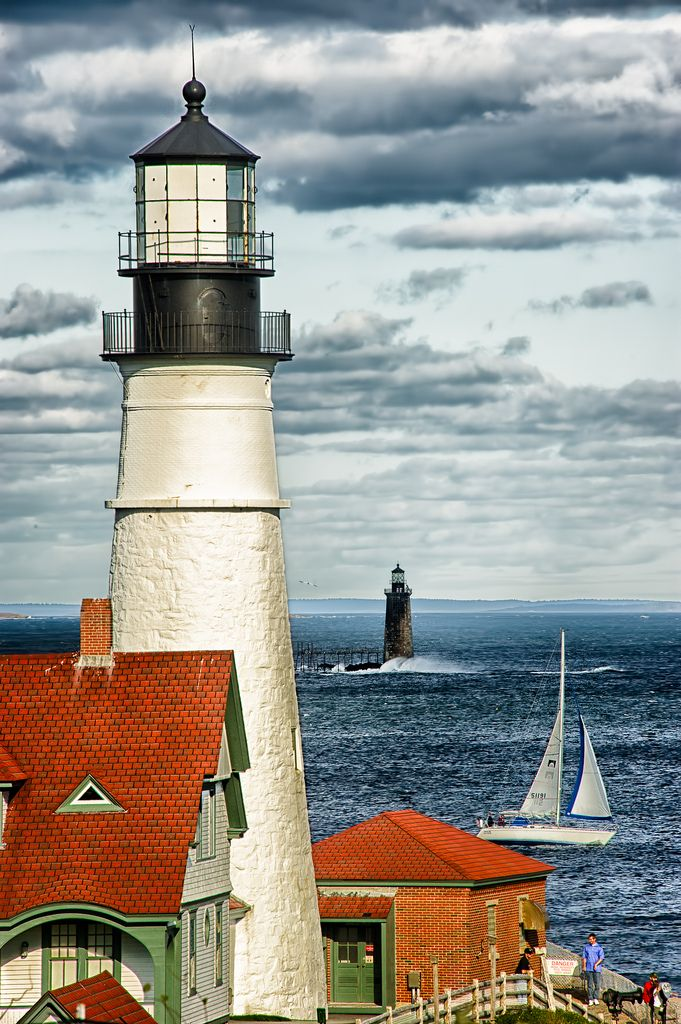 """Two Lighthouses In The Same Photo #2"" by howardignatius on Flickr - This photograph shows both the Portland Head Light and the lessor known Ram Island Ledge Light.  The Portland Light is a historic lighthouse in Cape Elizabeth, Maine - construction began in 1787.  Materials used were rubble masonry and brick.  Ram Island Ledge Light is a lighthouse in Casco Bay, Booth Harbor, Maine.  It is no longer open to the public."