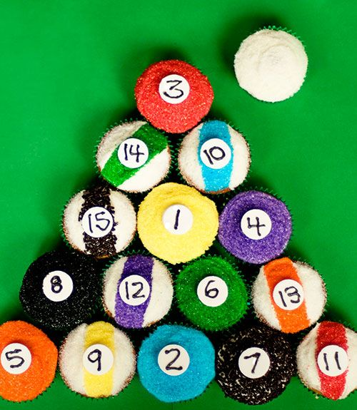 Colored sprinkles and Necco wafer numbers make these pool-table staples surprisingly easy to decorate. Get the recipe at With Sprinkles On Top.