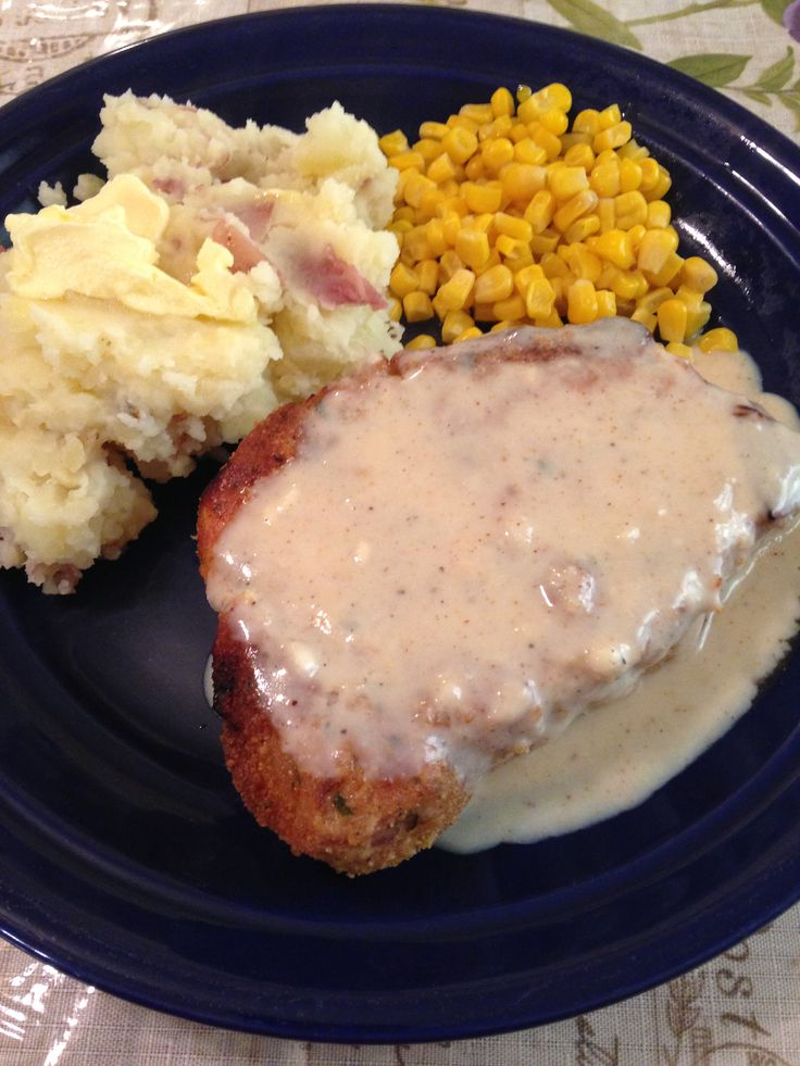 Pork Chop, Bread Crumbs, cayenne, chili powder, garlic, onion powders, black pepper,salt. blend and coat & bake 375Gravy 2 cups milk and all the above spices, thicken w flour. Red taters, (6)smash after boiling quarteres. 1/2 stick butter melt add 4 cloves minced garlic, simmer a couple min. add to taters with cuo milk, salt and pepper.