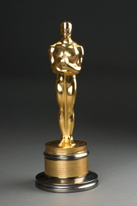 Honorary Oscar trophy from the American Academy of Motion Picture Arts and Sciences. Gilt- and silver-plated statuette presented to Helen for Helen Keller in Her Story, 1955