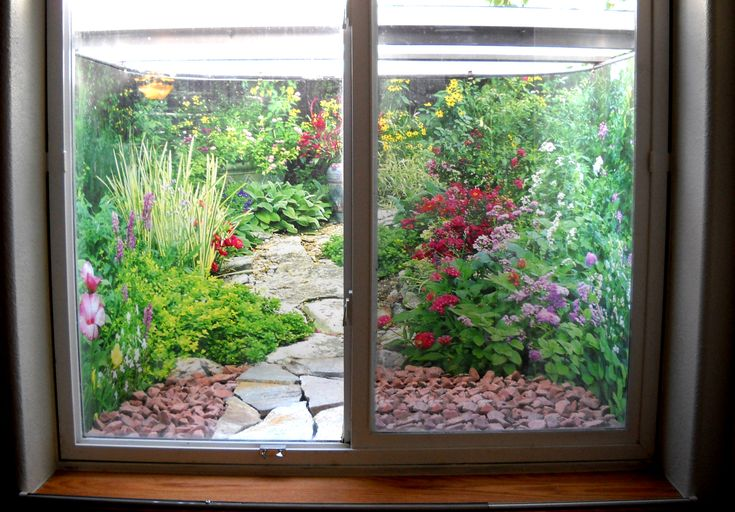An actual customer's window well filled with the Garden Window Well Scene.  #window #well #getbiggies