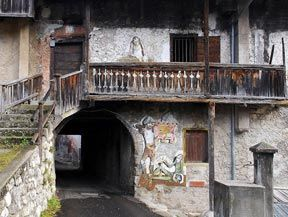 "CIBIANA DI CADORE, Belluno, Veneto. Municipality in Veneto is now identified as the ""Country of Murals"": with an initiative started in 1980, all walls of the houses at Cibiana have been covered by large frescoes with an decorative and historical value."