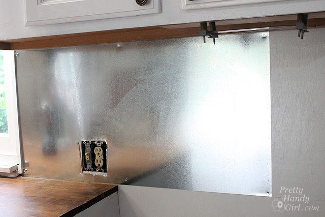 Install Your Own Magnetic Metallic Backsplash, this is inexpensive and should be really easy to clean.