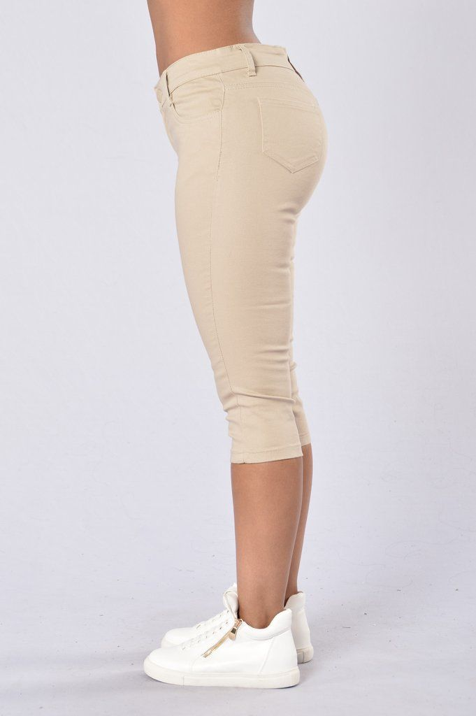- Available in Black, Navy, and Khaki - Mid Rise - 5 Pocket Design - Capri - Fitted - 97% Cotton, 3% Spandex