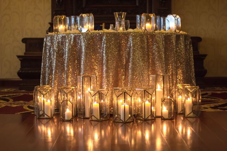 The gold sequin tablecloth sparkles with the romance of geoshapes filled with candlelight for Anna and Monzeil's sweetheart table at White Clay Creek Country Club.