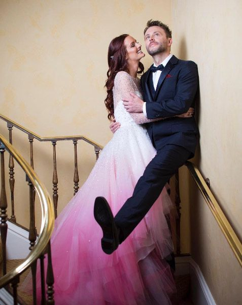 Lydia Hearst said 'I do' to her actor fiancé Chris Hardwick over the weekend, choosing to wow in a bespoke fuchsia and white wedding dress by Christian Siriano