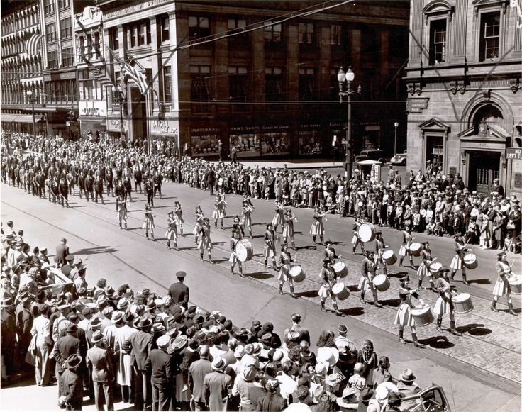 """A Labor Day parade fills Main street at the Corner of Court street in Buffalo, NY in this photo dated 1941. The Marching band is the """"East Love Joy Drum Corps"""""""