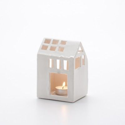 Maison tealight - $42= about £30  Airdrying clay and a glaze!? = £2