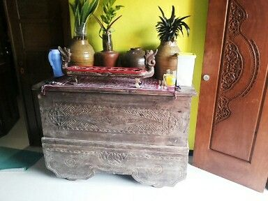 Antique Javanese Carved Chest (Gerobog Ukir). It is beautifully carved. It has 4 wheels. Made of teak.