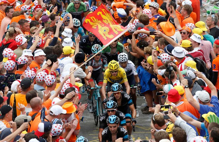 Race leader Yellow jersey holder Team Sky rider Christopher Froome of Britain cycles among a group of riders climbing the Alpe d'Huez mountain during the 172.5km eighteenth stage of the centenary Tour de France cycling race from Gap to l'Alpe d'Huez, in the French Alps on July 18. (Jean-Paul Pelissier/Reuters) - See more at: http://www.boston.com/bigpicture/2013/07/tour_de_france_100th_edition_p_1.html#sthash.Lx9uVNEJ.dpuf