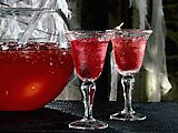 Blood Punch          1 (46-ounce) can red punch (recommended: Hawaiian Punch)      1 (46-ounce) can apple juice      1 (48-ounce) bottle cranberry juice      1 (2-liter) bottle ginger ale      Ice cubes      Berry vodka, optional      Orange liqueur, optional