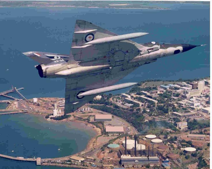 A3-24 75 Squadron Mirage IIIO over Darwin late 80s.
