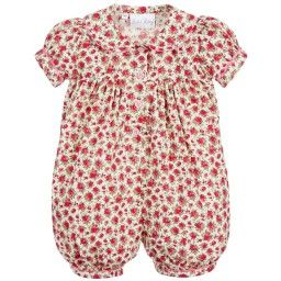Baby girls pink floral shortie byRachel Riley, made in a smooth, lightweight cotton. In a bubble style for added comfort, it has sweet, puffed sleeves and scalloped, pink trim around the collar, cuffs and placket. To make dressing easier, it has buttons down the front and between the legs to fasten.