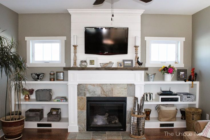 Shiplap Fireplace with Built-Ins and reclaimed wood mantle ~ www.theuniquenest.com