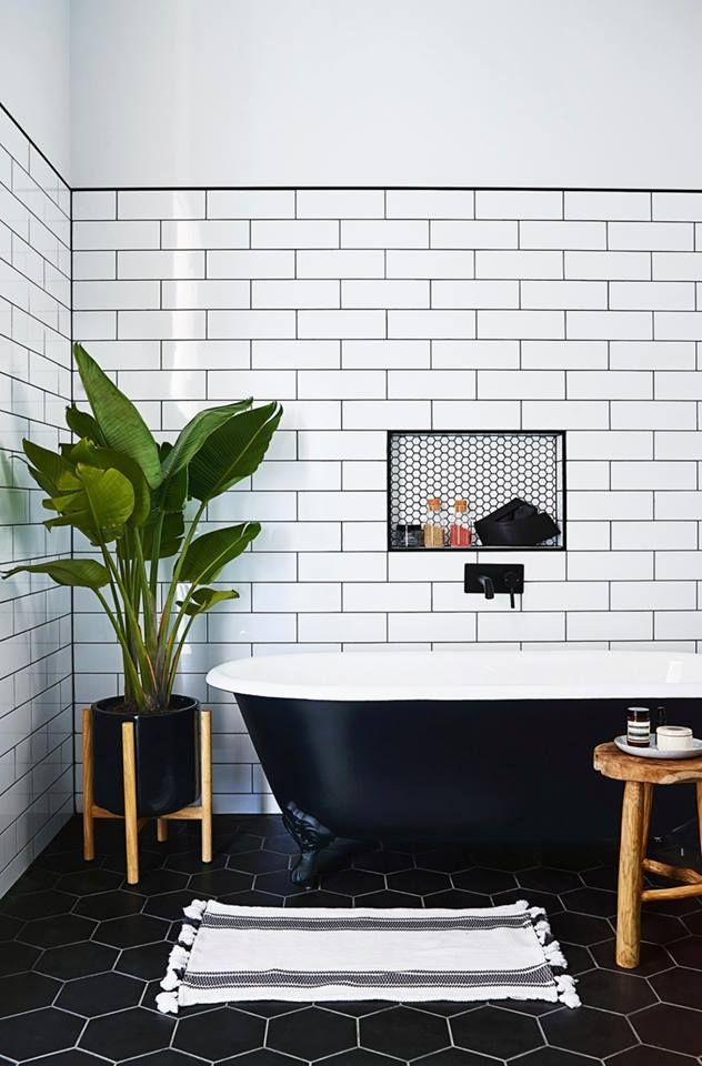 From the black hexagonal tiles on the floor to the white subway tiles on the walls, we love the mix of styles and colours in this bathroom.
